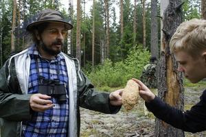 The teacher Mr. Kuvshinskiy shows mushroom