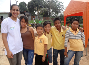A GROW intern with some of the youth