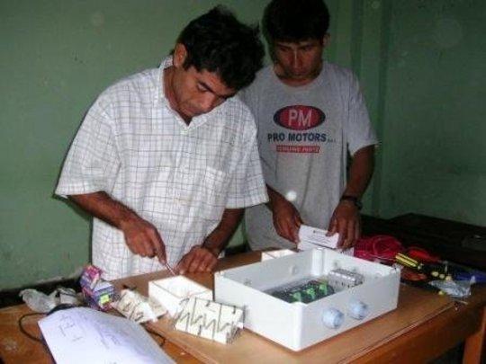 Community members wiring the school