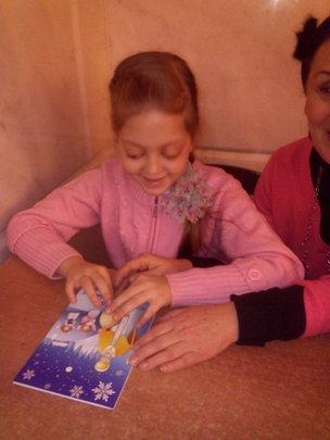 A blind girl Enjoying the Saint Nickolas card