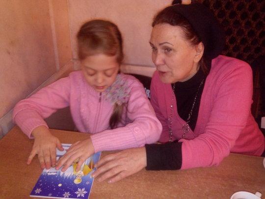 A blind girl Enjoying the Saint Nickolas card 2