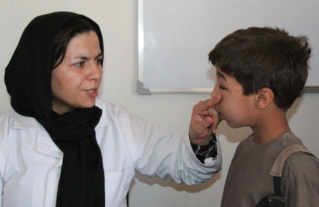 Patient and doctor at the private clinic.