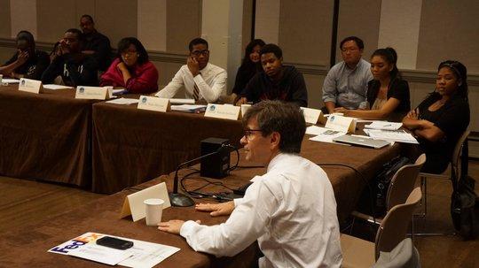 George Stephanopoulos engages students in debate.