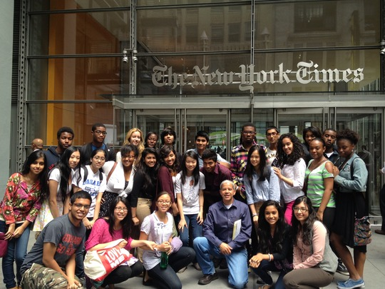 Students tour the New York Times news room.