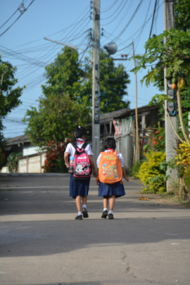 Two foster children on their way to school