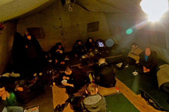 People in the heated tent in April