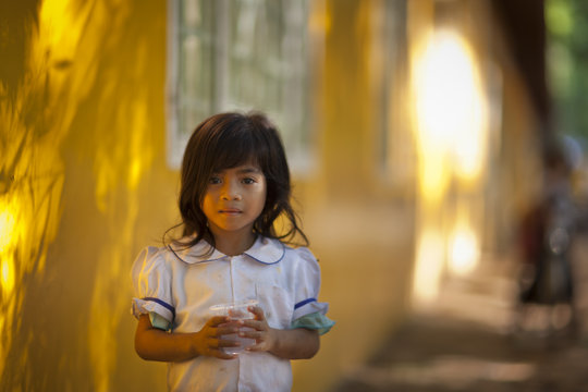 Cambodian girl with clean water