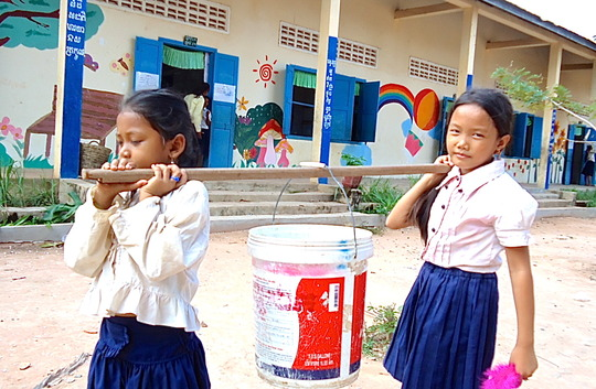 Girls Going to Collect Water