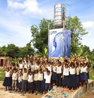 Students celebrating clean water