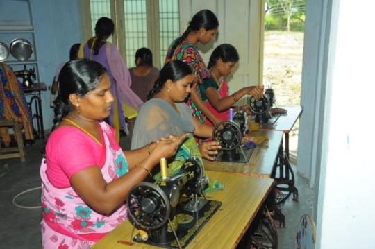 Women are practicing on Sewing machines