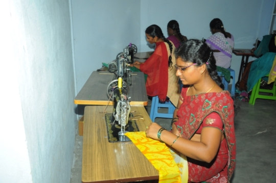 Women are practicing stitching of cloths.
