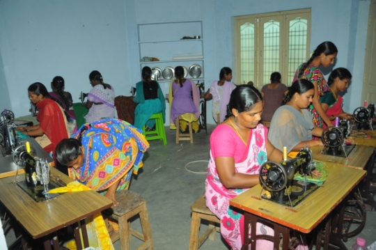 Ladies are practicing on sewing machines