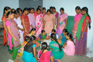 Adolescents are practicing Maggam work on cloth