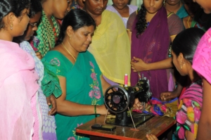 Adolescents are learning on Sewing machine.
