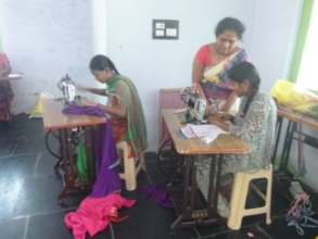 Girls are practicing sewing of cloths