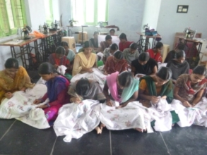 Girls are being taught Hand Embroidery skill