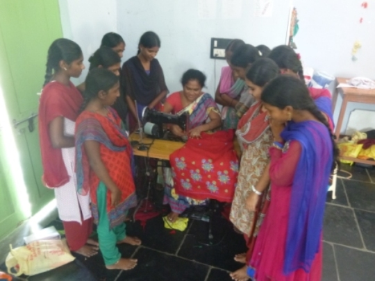 Girls are being taught sewing of cloths