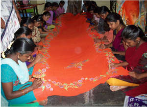 Girls learning painting the Sarees