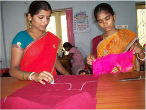 Adolescent girl learning cutting the cloth
