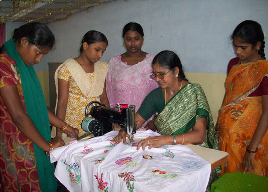 Girls learning hand embroidery