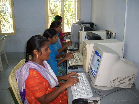 Trainees in computer class room