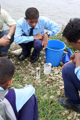 Students conducting test on parameters of water