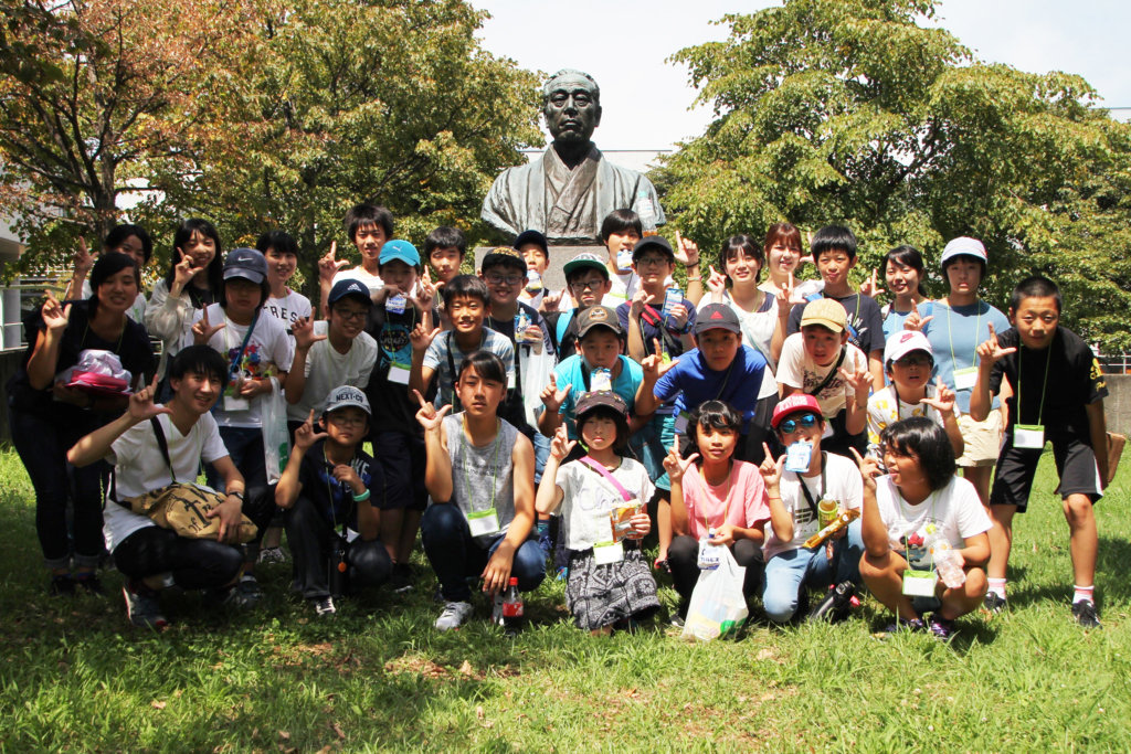 Gathering at the statue of the univ. founder