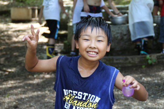 A boy in a water game