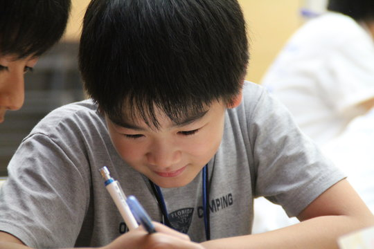 A boy is drawing