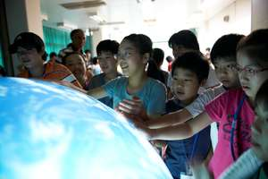 Children touching the tangible Earth