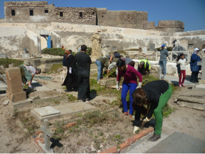 Students help clean the cemetery