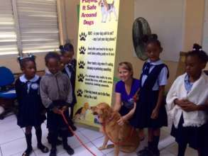 Shelley & dog Harriet educating school children