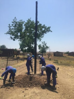 Installing  poles for electrical distribution wire