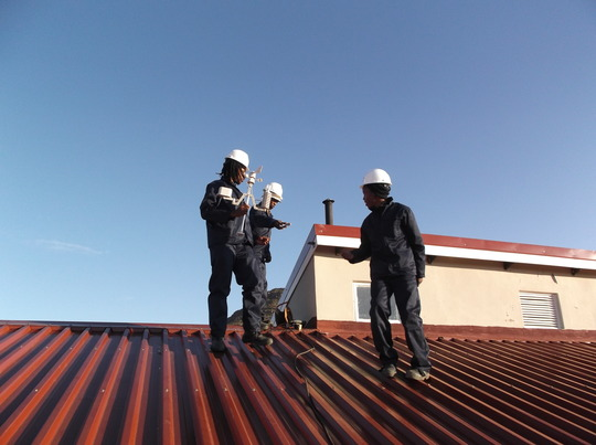 STG Interns install a weather station at a clinic