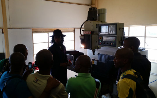Students learn about CNC milling from Marcel