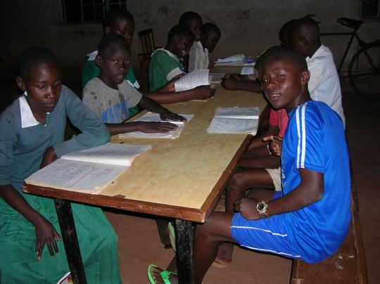Children at Good Samaritan studying with new books