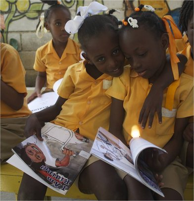 LitClub Girls Read Explore Books in Haitian Creole