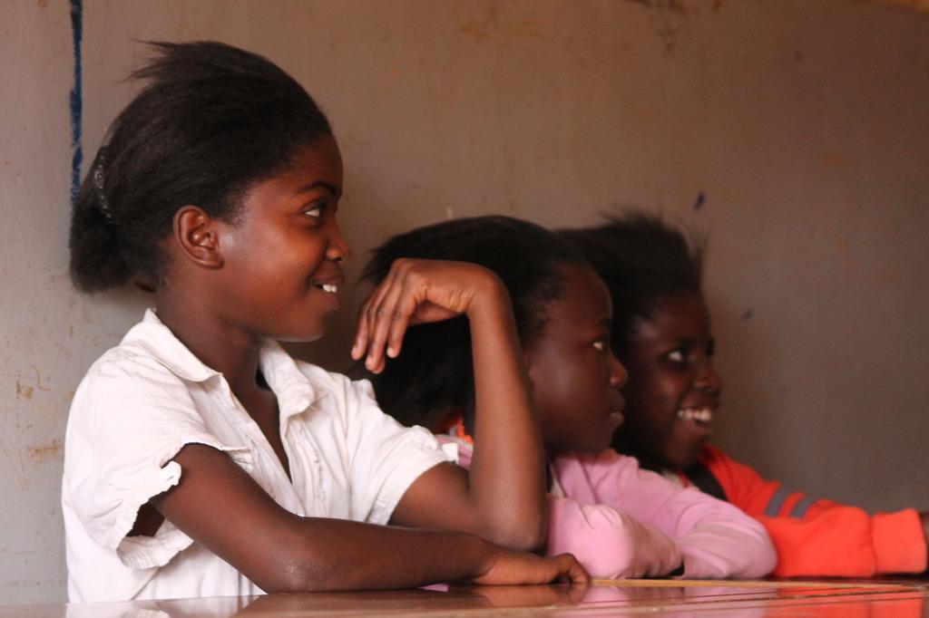 Zambia LitClub members soaking up a read aloud.