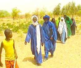 Gao families walking out to women's & youth garden