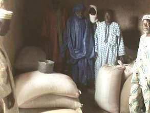 Gao elders receiving donated rice seeds