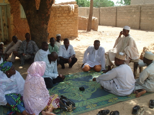 Discussion with the district head of the community