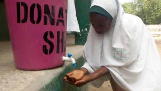 A junior high 3 washing her hands