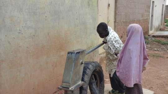One of the rehabilitated hand pumps