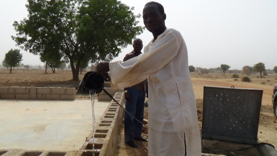 Salisu fetching water from one of the tubewells