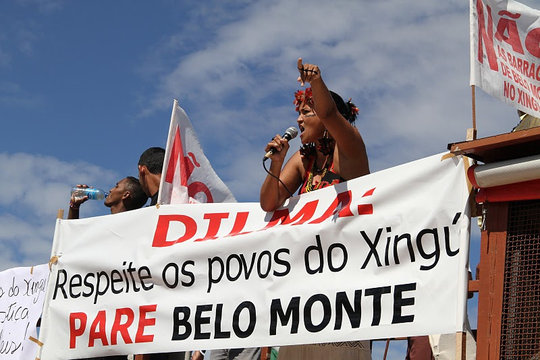 An opposition leader protests against Belo Monte.