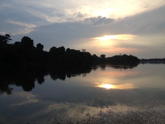 The sun sets over the Xingu River in the Amazon.
