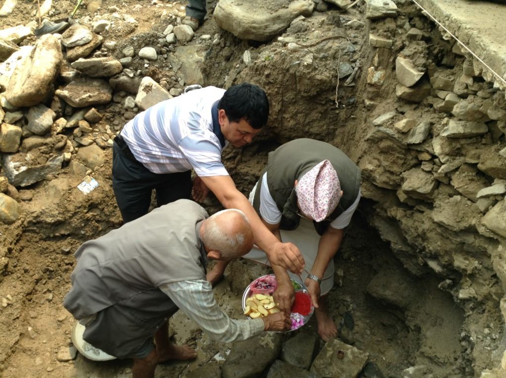 Foundation stone being laid by village senior.