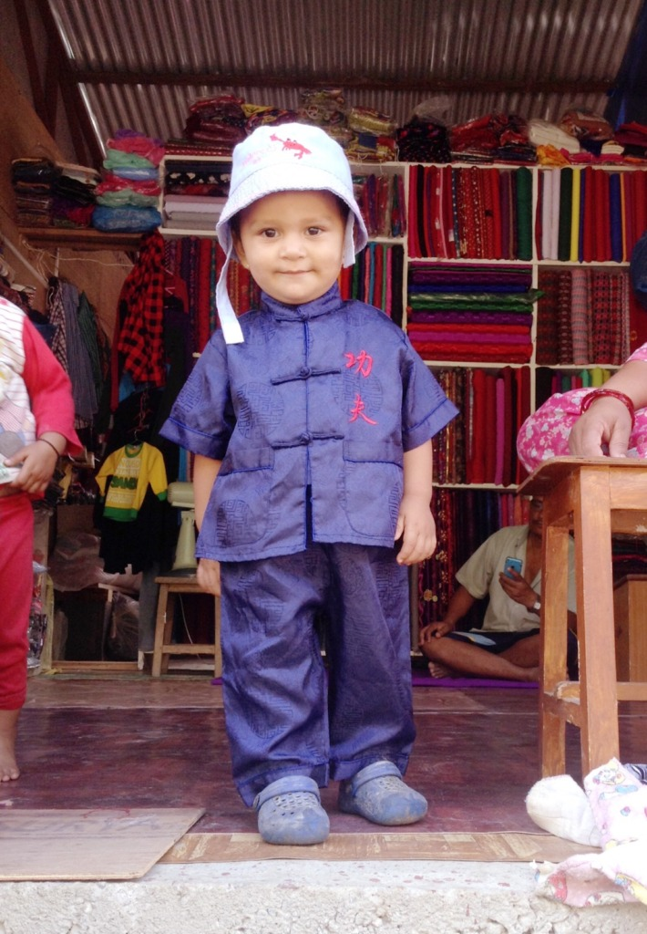 A Nepali villager welcomes our new volunteer!