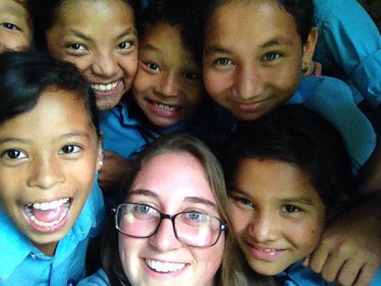 MMW Volunteer, Amanda, with Nepali Children