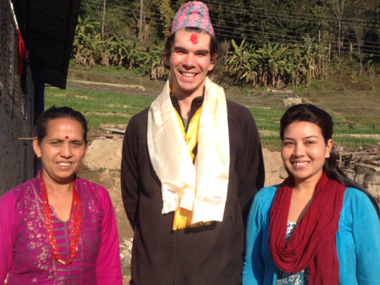 Michael Cole with clinic midwives, Mina and Bina.